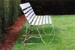 Painted wooden bench on lawn