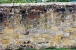 Old sandstone wall with capping