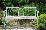 Painted metal bench with alchemilla