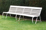 Painted wooden bench with yew hedge
