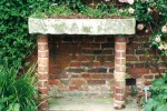 Stone and brick planting trough with roses