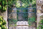 Blue metal gate in sandstone wall
