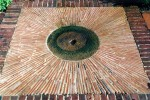 Old millstone, tile and brick paving detail