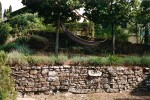 Hammock with drystone wall and lavender
