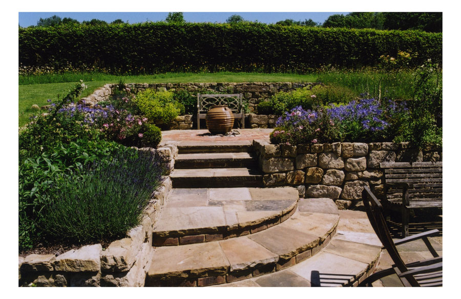 curved york stone steps and top terrace garden design by