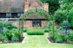 Barn with arch and clematis