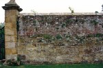 Old brick and sandstone wall with pier