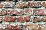 Close up of old brick wall and mortar joints