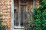 Wooden door and steps in brick wall