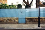 Blue railings with fence and gate